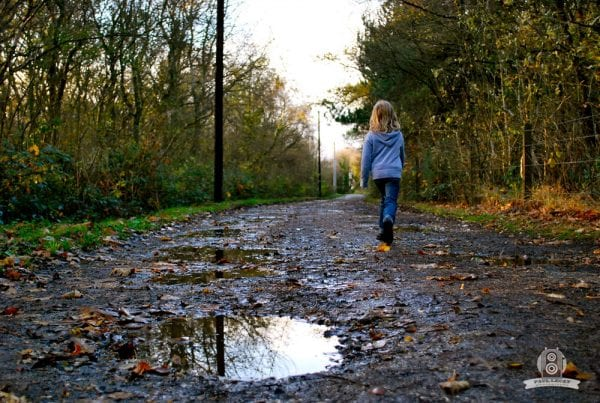 Kid walking alone in countryside